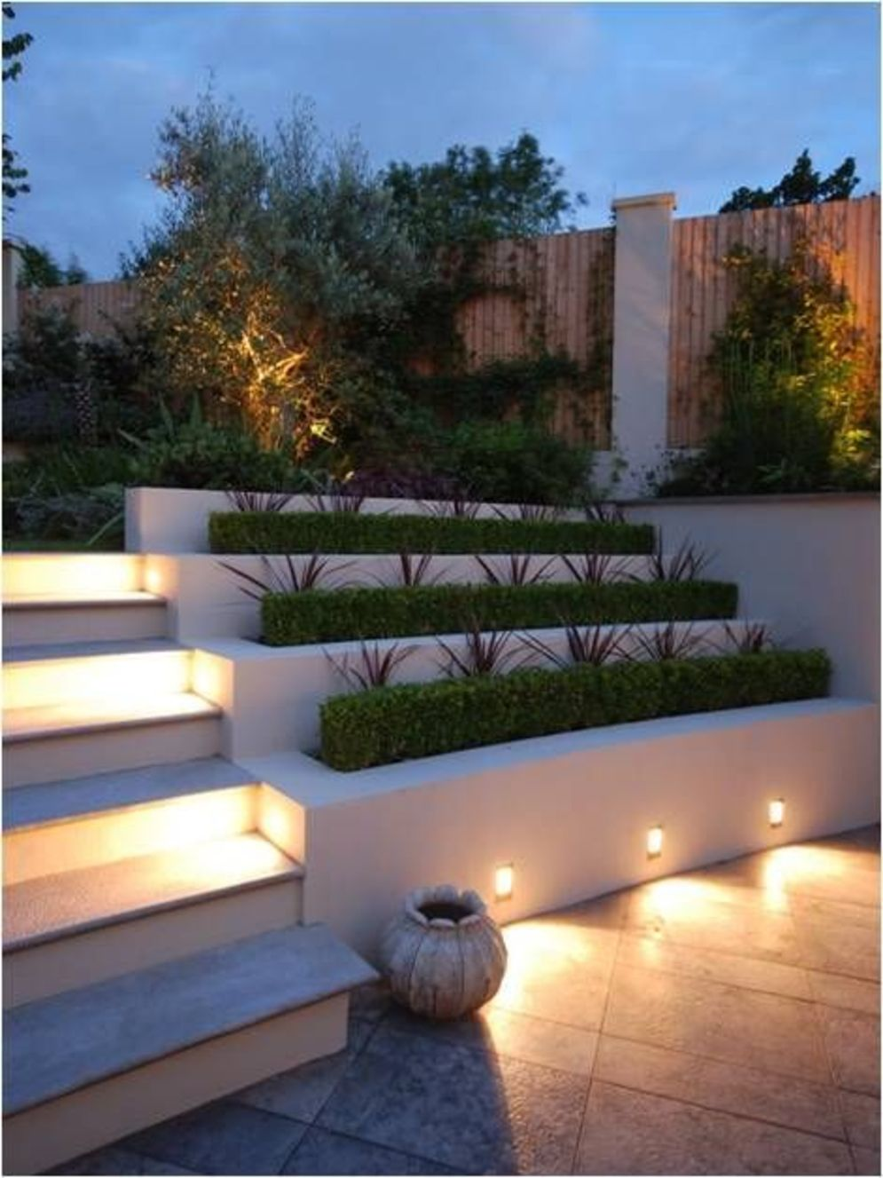 Beautiful garden lighting ideas with ground level ambient light giving luxurious resorts look Image 33