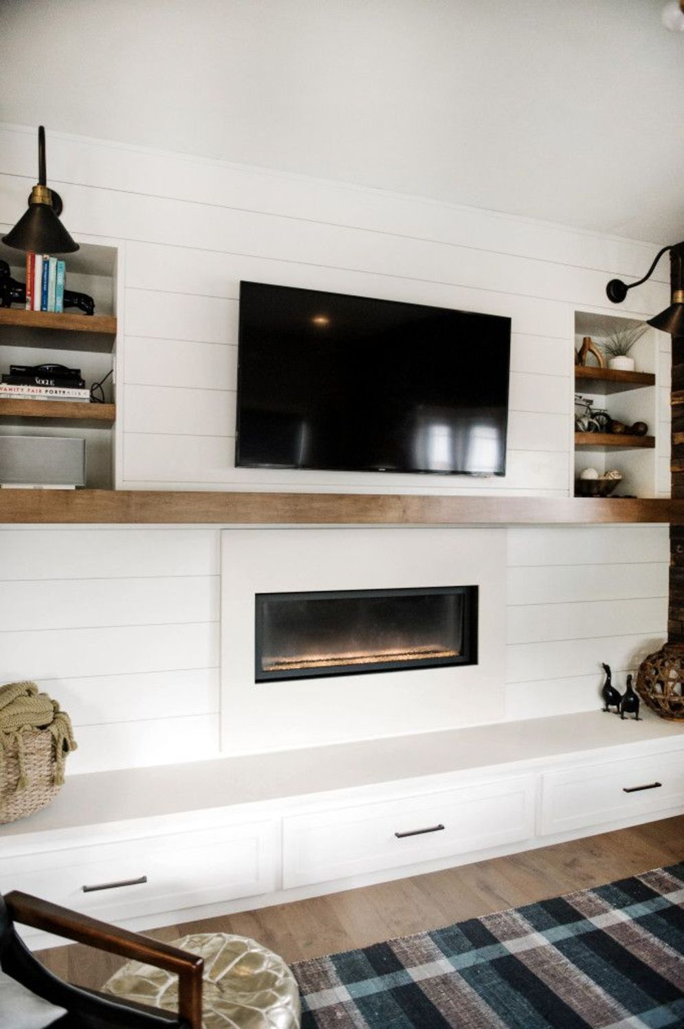 Efficient living room decoration giving exotic combination of gas burning fireplace and TV wall Image 18