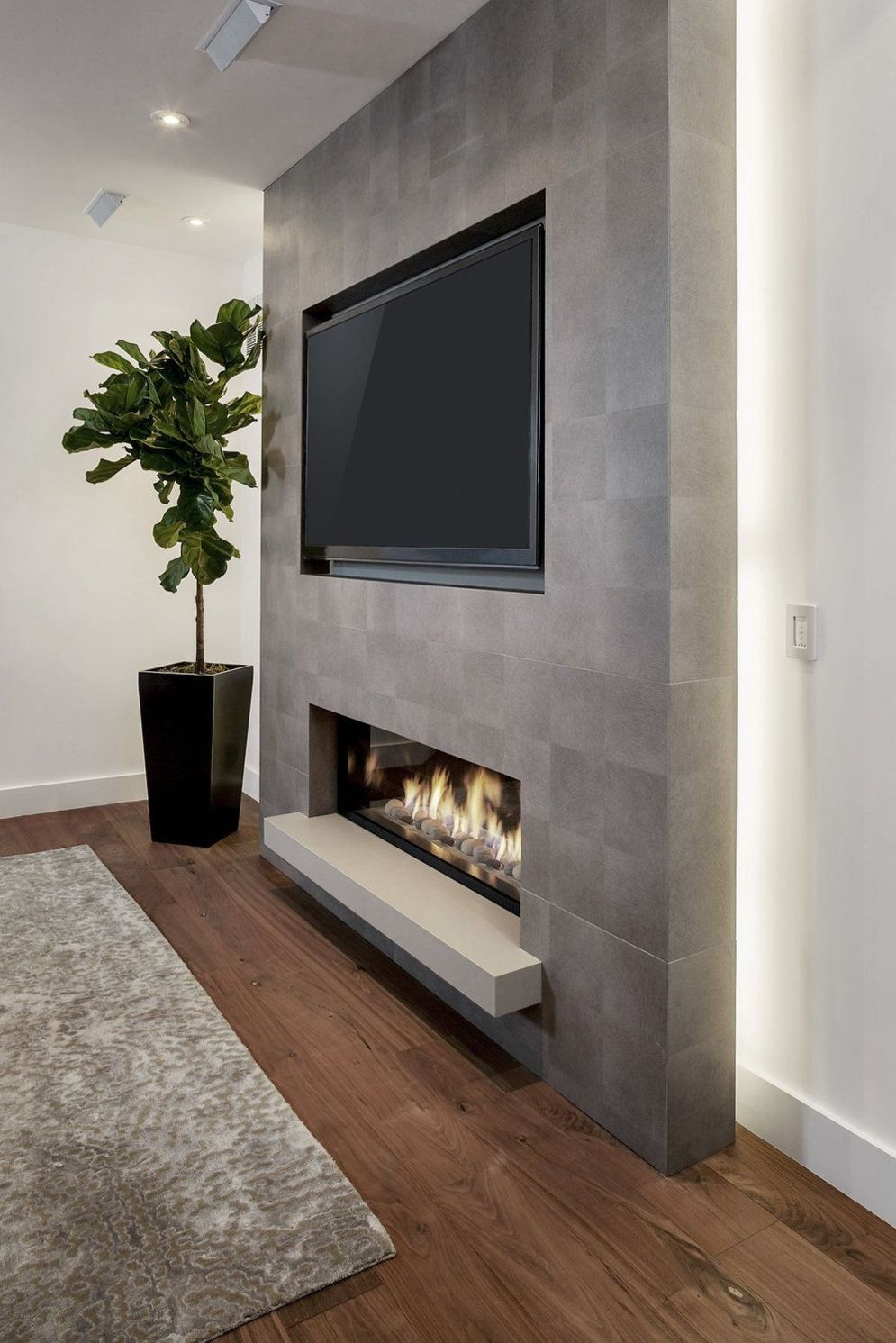 Efficient living room decoration giving exotic combination of gas burning fireplace and TV wall Image 24