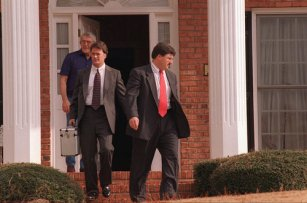 970103 Roswell, Georgia - Boulder Police Investigator Steve Thomas exits the Roswell, Georgia home of the grandparents of six-year-old JonBenet Ramsey with a metal case of contents unknown Friday afternoon, January 3, 1997 along with Investigator Thomas Trougillo (right) and an unknown family member. Ramsey was found dead in her Colorado home December 26. (Special to the AJC/Randall Richards)