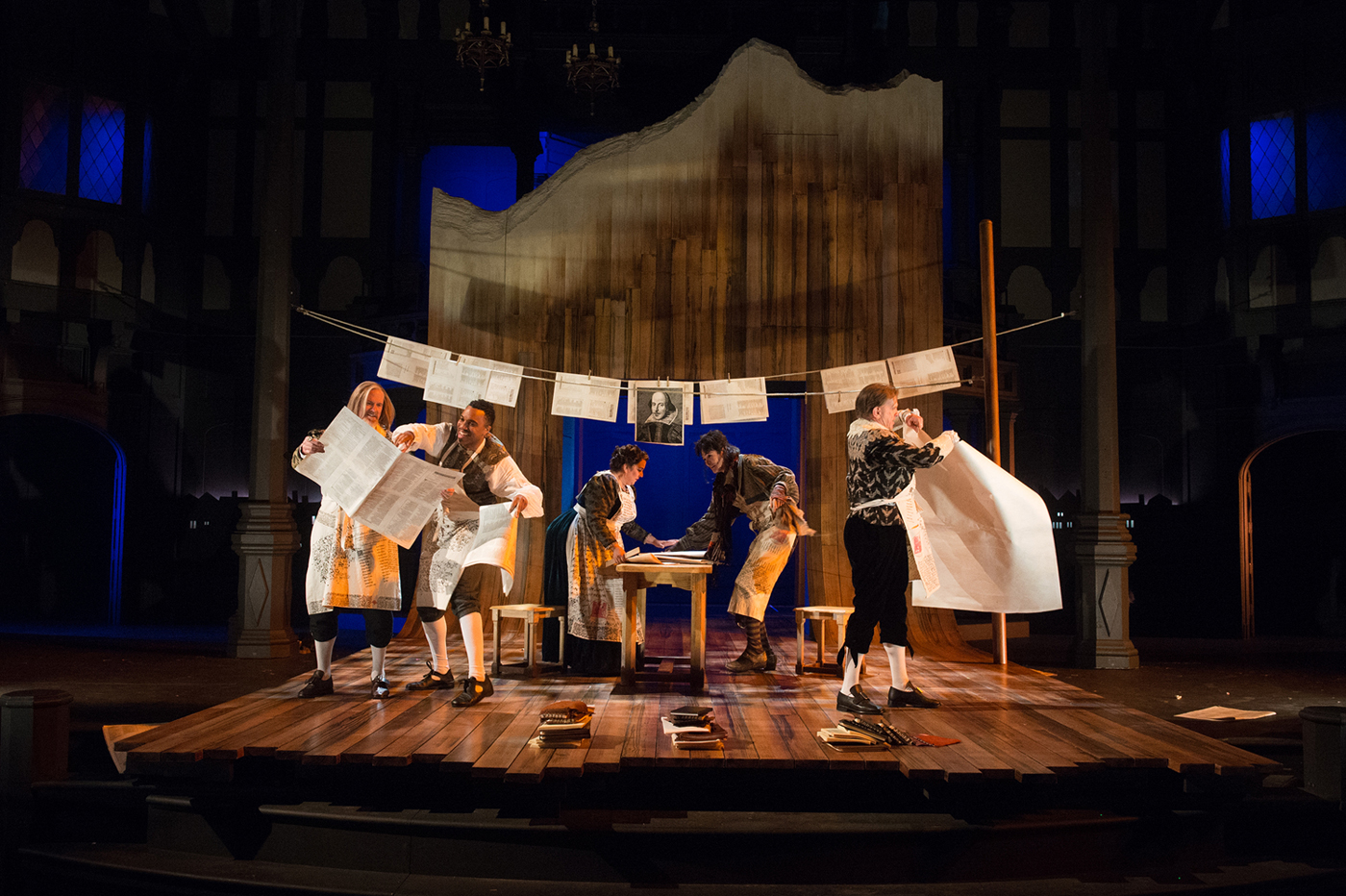 """Printers hang pages of the First Folio up to dry in """"The Book of Will"""" at the Oregon Shakespeare Festival"""