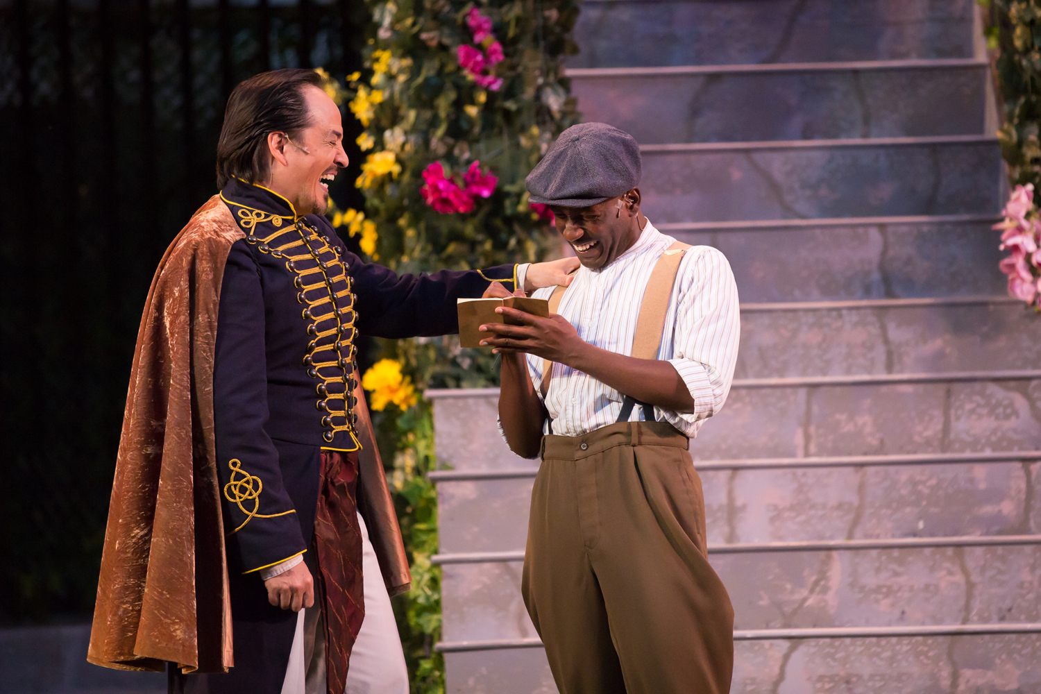 Don Armado and Moth laught together in the Colorado Shakespeare Festival's Love's Labor's Lost.