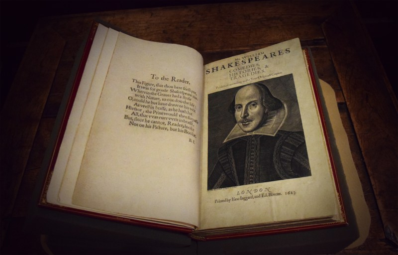 Shakespeare's First Folio, open to the Droeshout portrait of Shakespeare and, on the facing page, a dedicatory verse by Ben Jonson