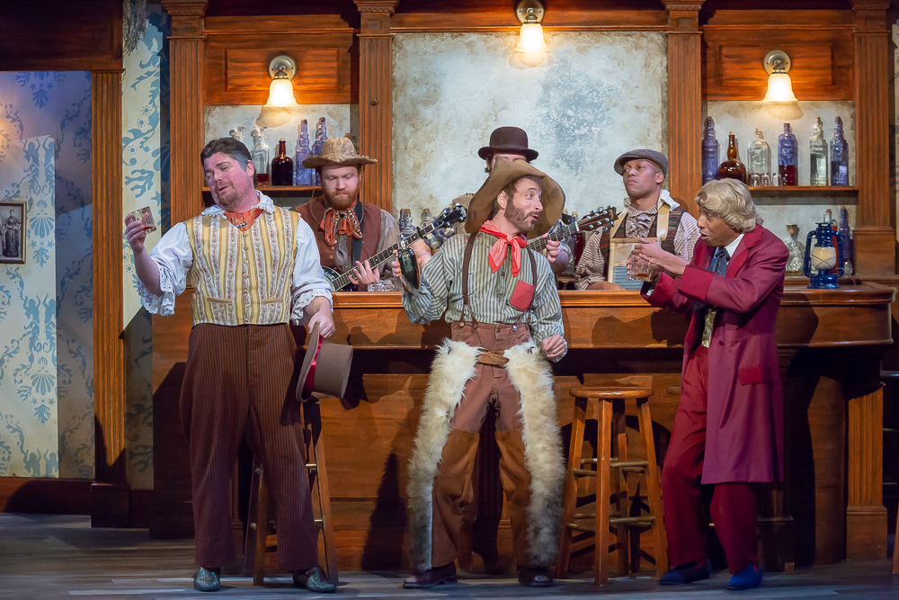 "(Front row, from left) Billy Chace as Sir Toby Belch, Paul Riopelle as Feste, Geoffrey Warren Barnes II as Sir Andrew and cast of Cincinnati Shakespeare Company's 2018 production of ""Twelfth Night"", directed by Austin Tichenor. By Mikki Schaffner Photography."