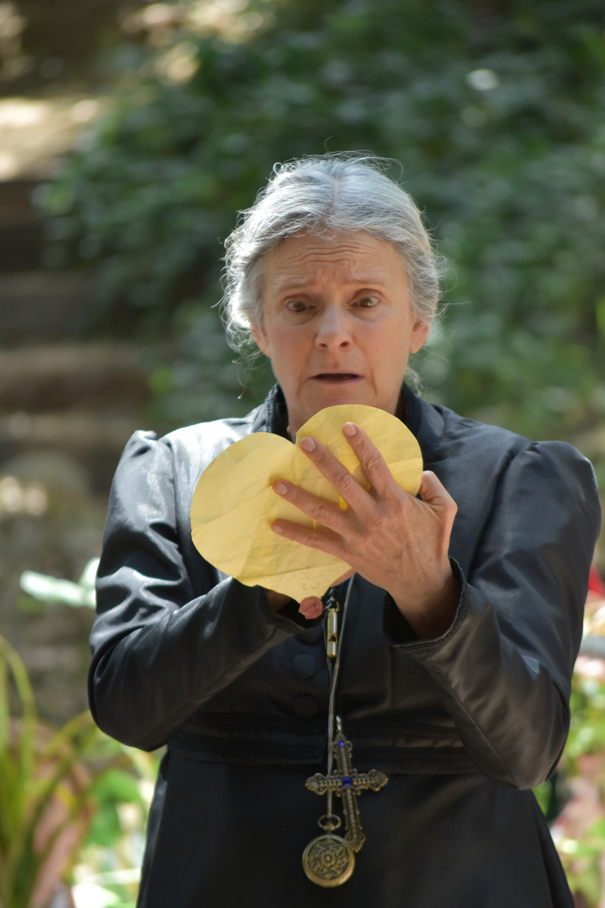 Malvolio, played by actress Melora Marshall, reads a heart-shaped letter in 'Twelfth Night' at Will Geer's Theatricum Botanicum