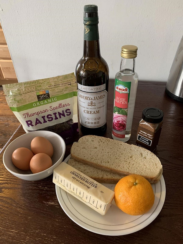 Eggs, raisins, and orange, butter, bread, and other ingredients