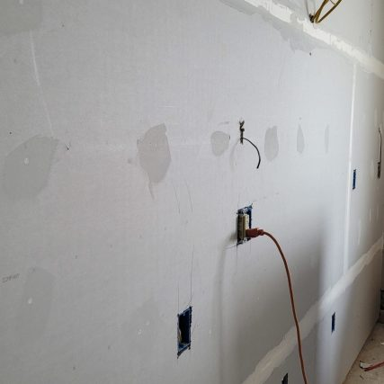 partially finished drywall- taped with the first layer of drywall mud.