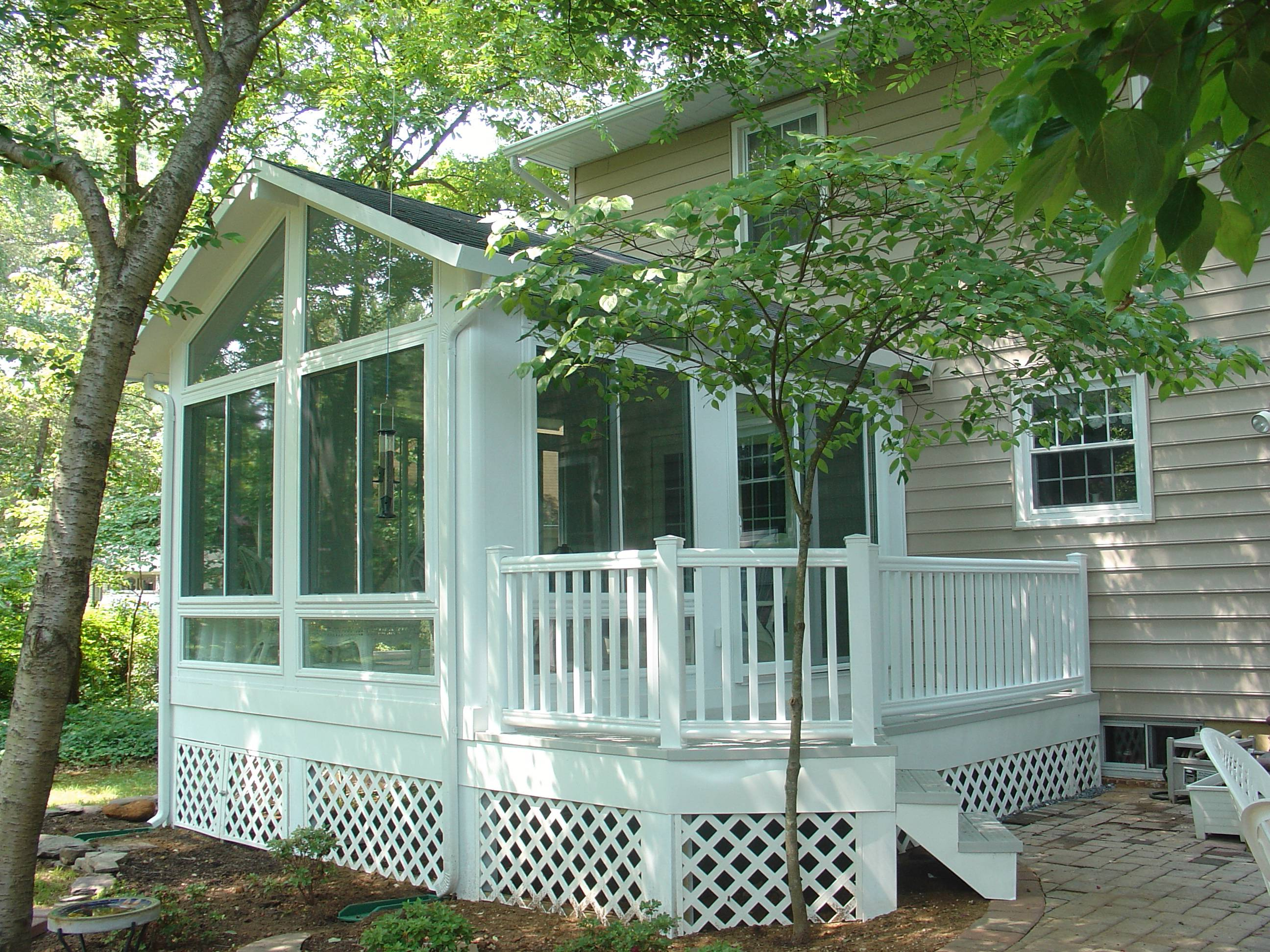 Sunrooms patio enclosures design gallery shakespeare for Backyard sunroom