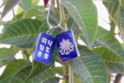 Tibetan om lotus symbol charms
