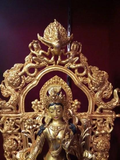 white tara gold statue face