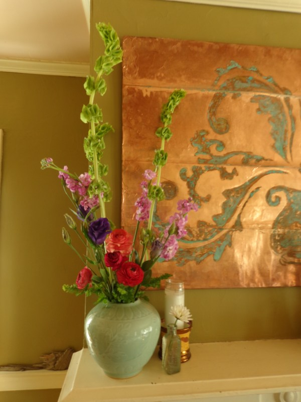 Bells of Ireland, ranunuculus,lisianthus, and stock on the mantel from Fresh Flowers post on Shalavee.com