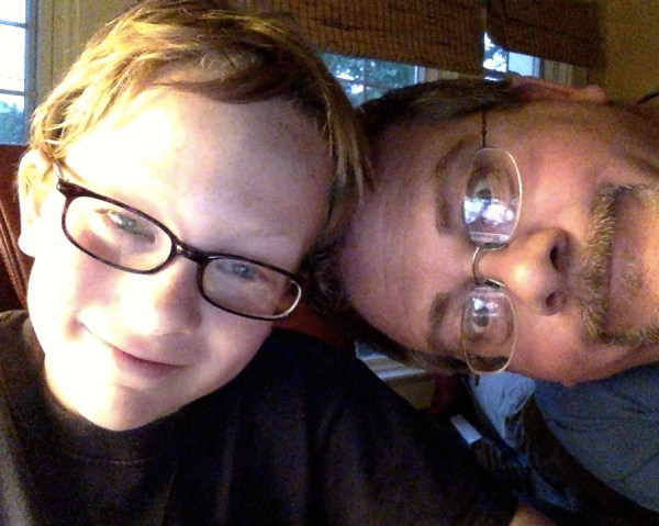 Eamon and Daddy playing with the new apple laptop on Mothering in thirds from Shalavee.com