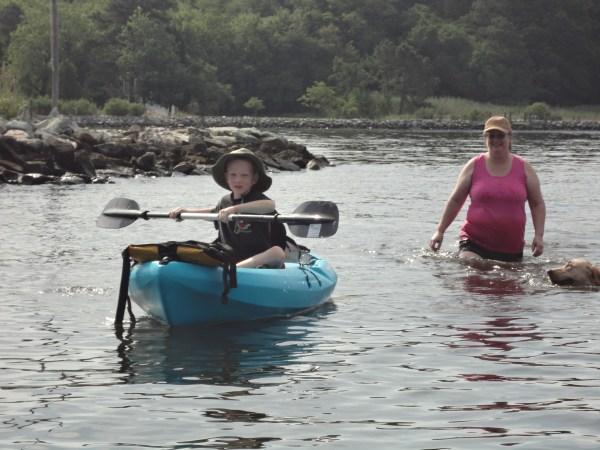 Eamon breaks in Tyla's new kayak