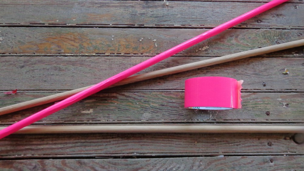 hot pink tape on wooden dowels as curtain rods on Shalavee.com