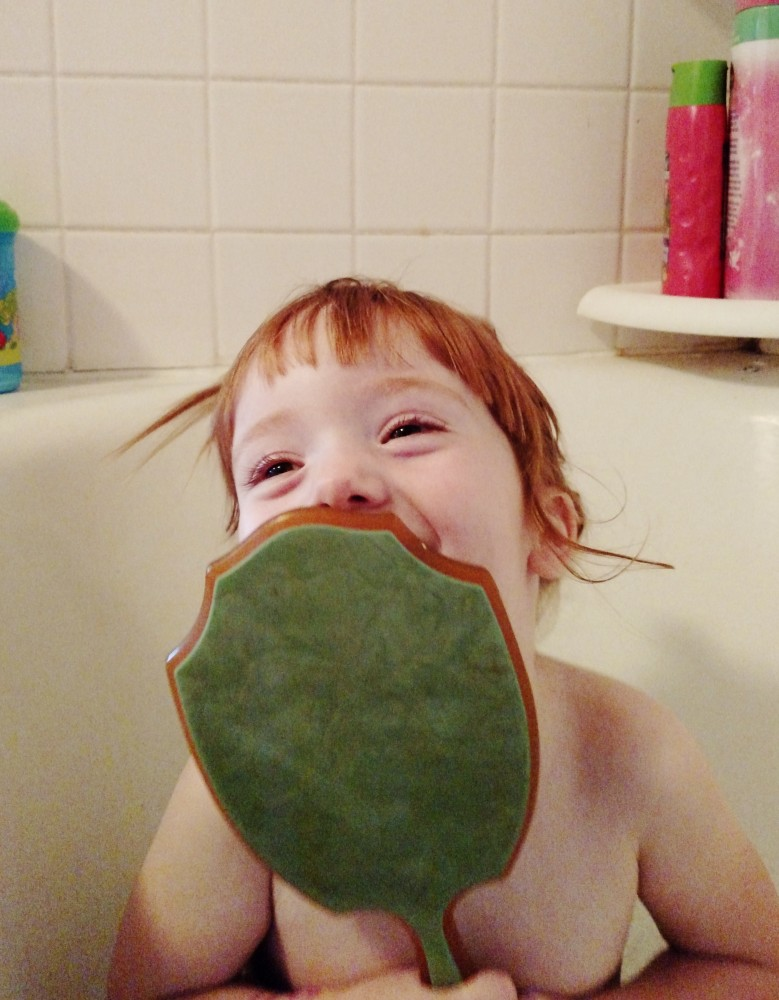 Fiona in the tub with a hand mirror 2 on shalavee.com