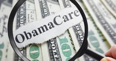Obamacare newspaper headline on cash with magnifying glass