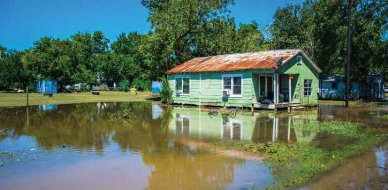 bigstock--203228227 - Old Poor Home relfection Flooded after Hurricane Harvey destroyed the town of Columbus , Texas southwest of Houston , Texas a Small Town Disaster easily overlooked wide angle view