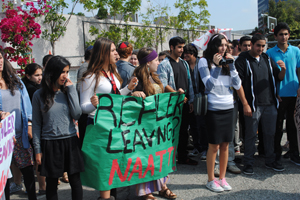 NAAT! The rally to save Rabbi Naftali Richler's job started on the Sport Court at the end of breakfast, with posters and cheers mimicking the longtime teacher's distinctive way of saying that something's incorrect or untrue. Students said Rabbi Richler was dear to them because of his 'non-judgemental' way of encouraging them to perform mitzvot.