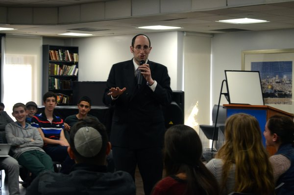 INSPIRING: Rabbi Meir Soloveitchik engaged students with smiles Dec. 12.