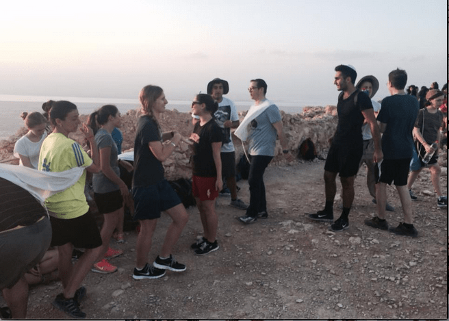 SUNRISE%3A+With+Rabbi+Segal+at+center%2C+members+of+the+class+of+2014+look+out+over+the+Negev+from+the+top+of+Masada%2C+which+they+had+climbed+before+dawn.