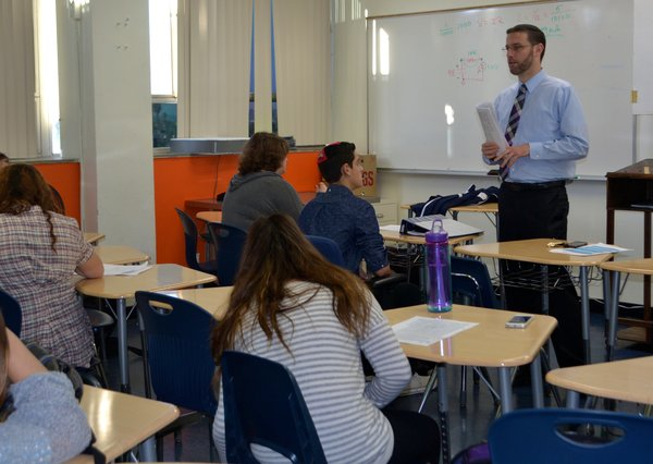 INSTRUCTING: Rabbi Jason Weiner took over Mrs. Segal's Talmud class on October 30th.