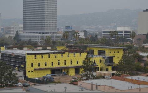 New building reveals its shape in views from parking structure