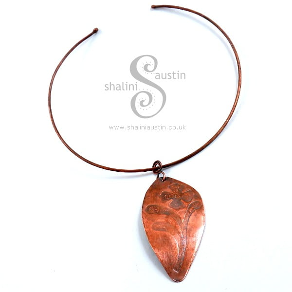 Embossed Copper Pendant on Torc Necklace