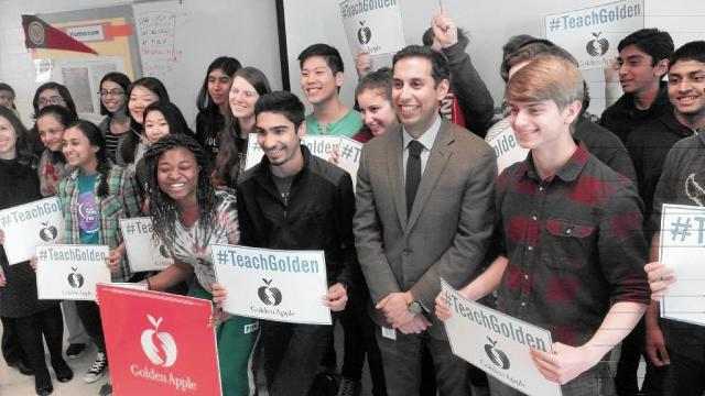 Niles High School teacher Pankaj Sharma, second from right, shared his Golden Apple Award honor with students in April 2016. (Mike Isaacs / Pioneer Press)