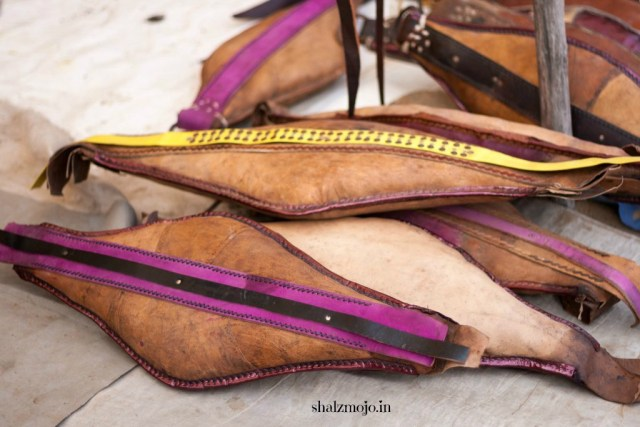 A2Z-BADGE-2017-blogging-challenge-theme-reveal-travel-stories-picture-speaks-louder-than-words-april-shalzmojosays-roadtrip-girltravel-india-Pushkar - leather-water-bottle-chhaggar-desert-rajasthan-camel-fair
