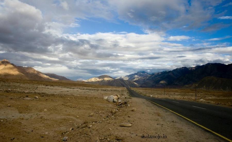 Unzymotic-A2Z-BADGE-2017-blogging-challenge-theme-reveal-travel-stories-picture-speaks-louder-than-words-april-shalzmojosays-highest-toilet-changla-pass-ladakh-leh-monastery-roadtrip-girltravel-india-drass-kargil-sonamarg-magnetic-hill-leh