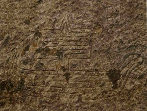 Sailed boat rock carving