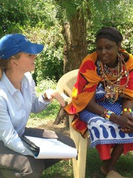 Anne Marie, the series producer, speaks to one of the farmers.