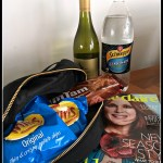 A Bag of chips, wine, chocolate, lemonade and magazine. A parody of a bug out bag for the apocalypse.