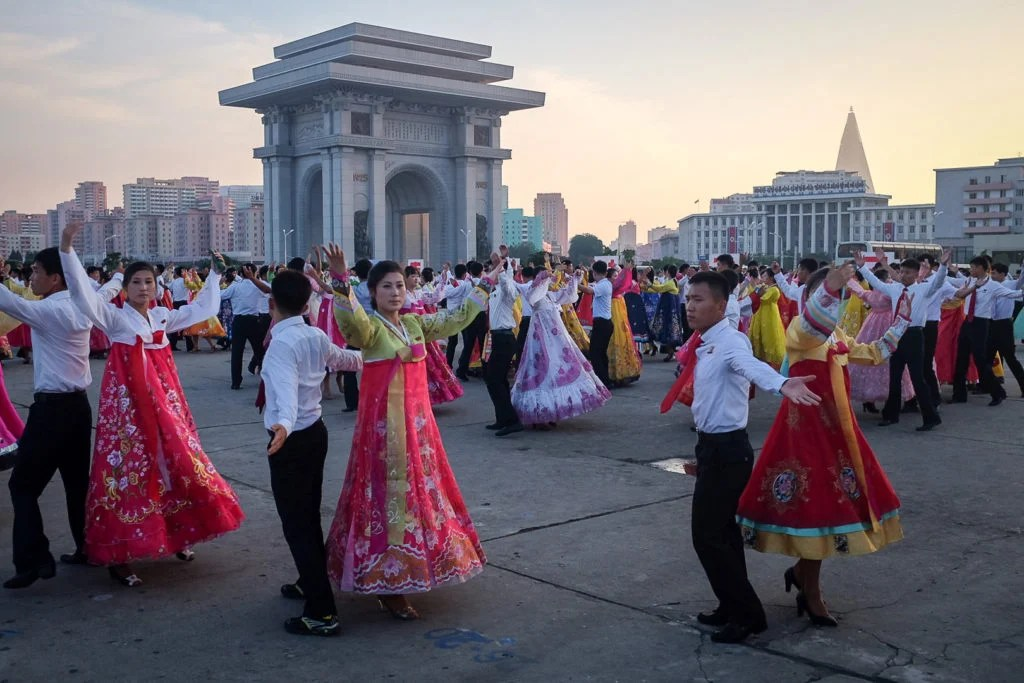 Students perform at the Pyongyang Arch of Triumph, North Korea