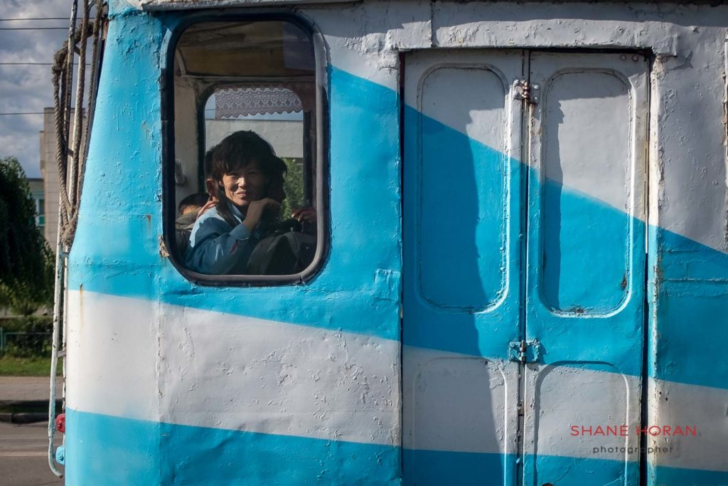 Passing commuter in Chongjin city, north Hamgyong. North Korea.