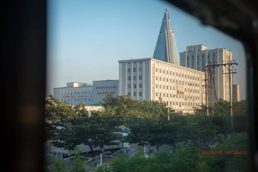 The Ryugyong hotel seen from a train window arriving into Pyongyang station. North Korea.