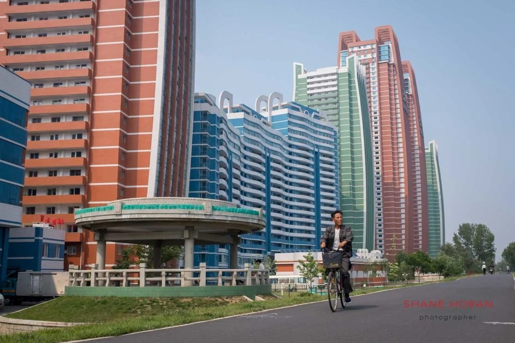 Cycling along Mirae, Future Scientist Street, Pyongyang, North Korea