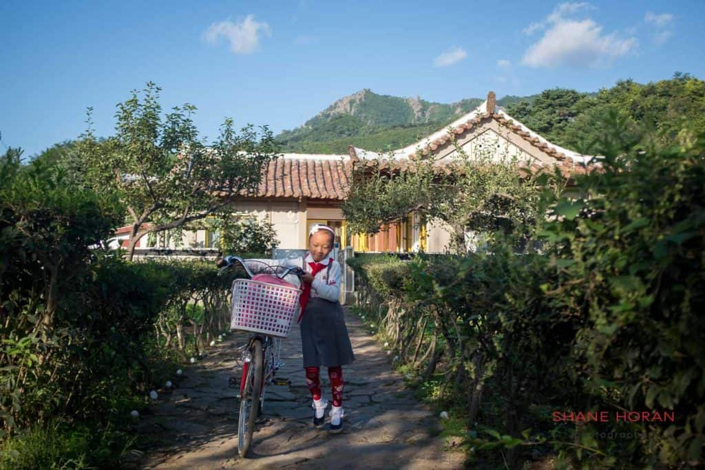A child leaves her house in the morning bound for school. Chilbosan, north Hamgyong. North Korea