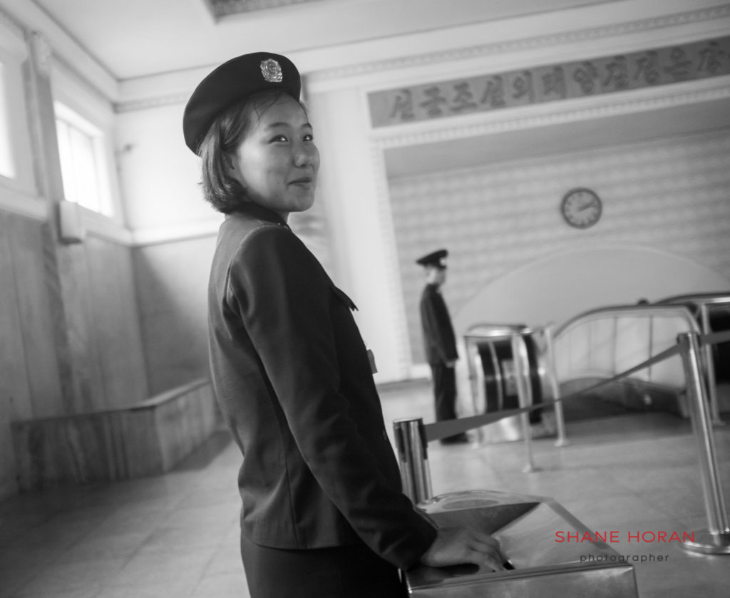 Ticket checker, Pyongyang metro. Pyongyang, North Korea