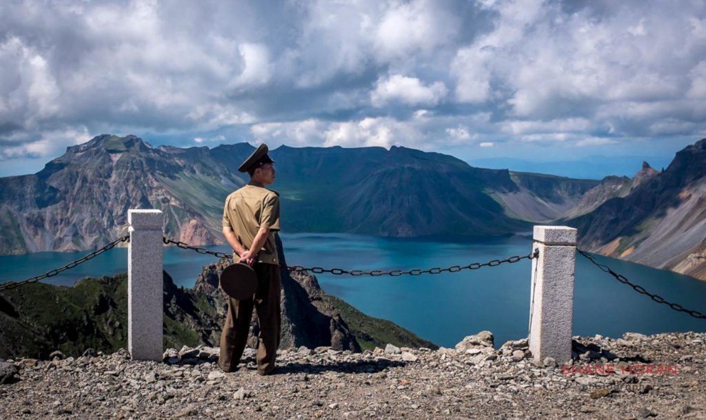 Korean peoples army officer at the summit of Mt Paektu, North Korea