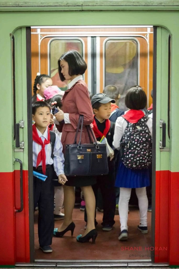 Woman enters the metro in Pyongyang, North Korea