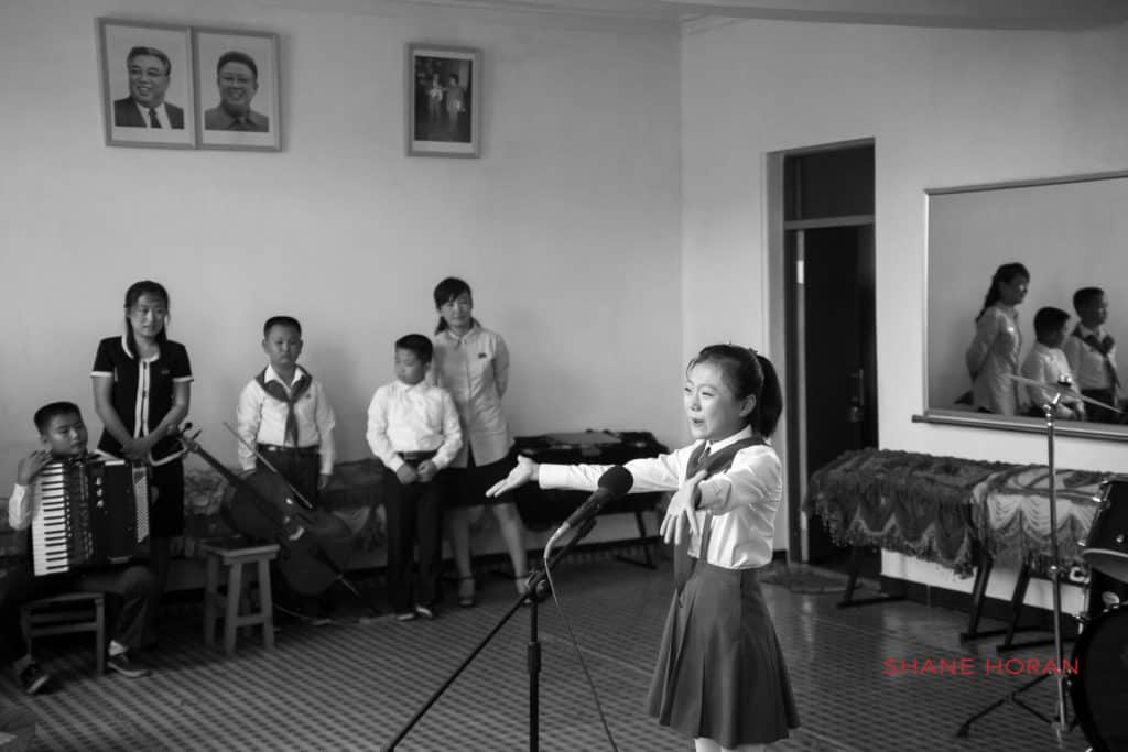 Schoolgirl putting on a show in a Pyongyang school. North Korea