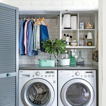 Front Loading Washer and Drying Laundry Room in a Closet