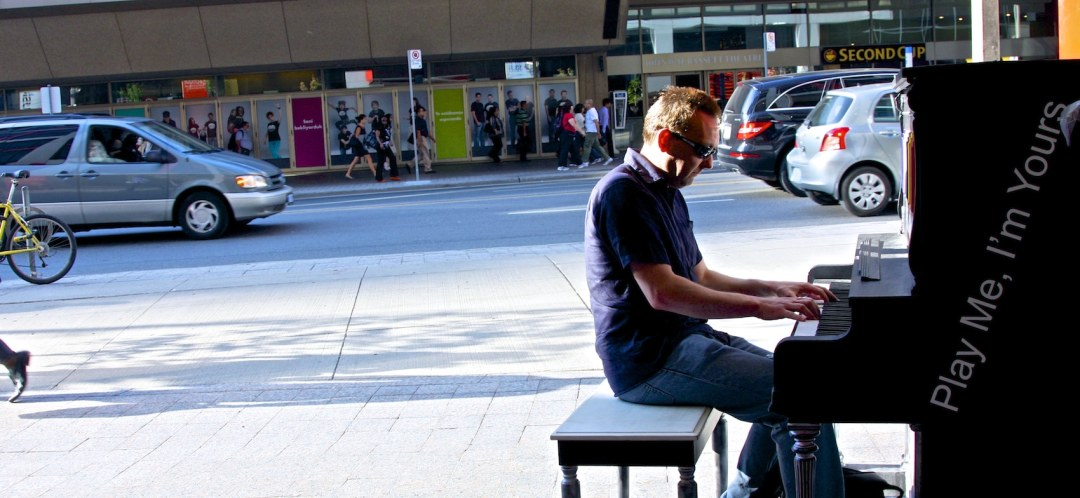 Me playing a street piano in Toronto, Canada