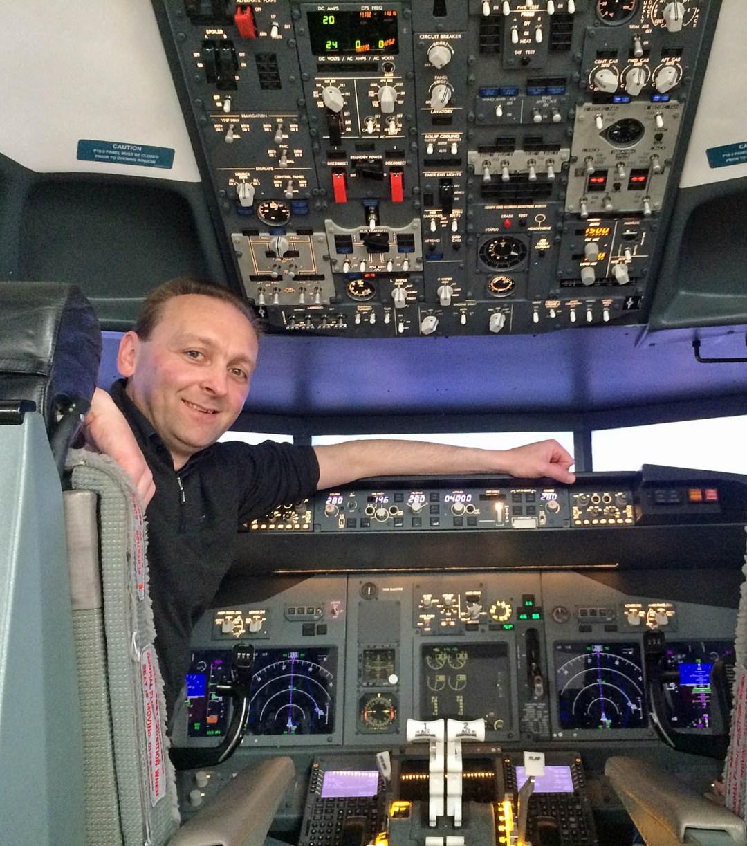 Shane McDonald at the controls of a Boeing 737 flight simulator