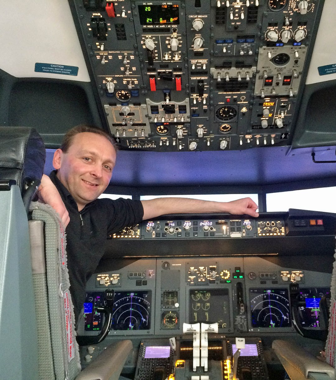 Shane McDonald at the controls of a Boeing 737 flight simulator