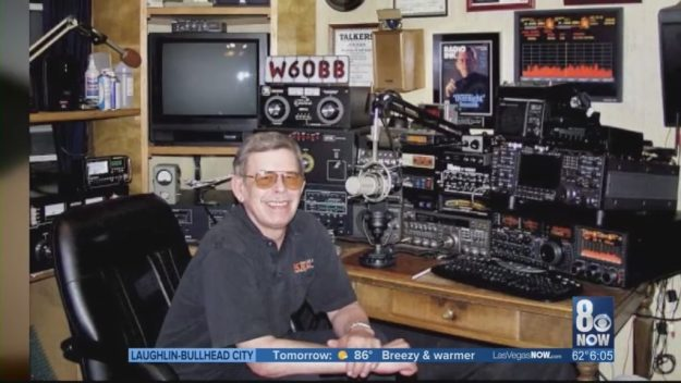 art bell smiling in front of radio equipment
