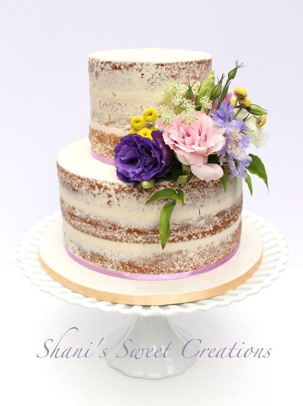 semi-naked wedding cake with fresh flowers