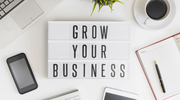 A grow your business sign to encourage online business