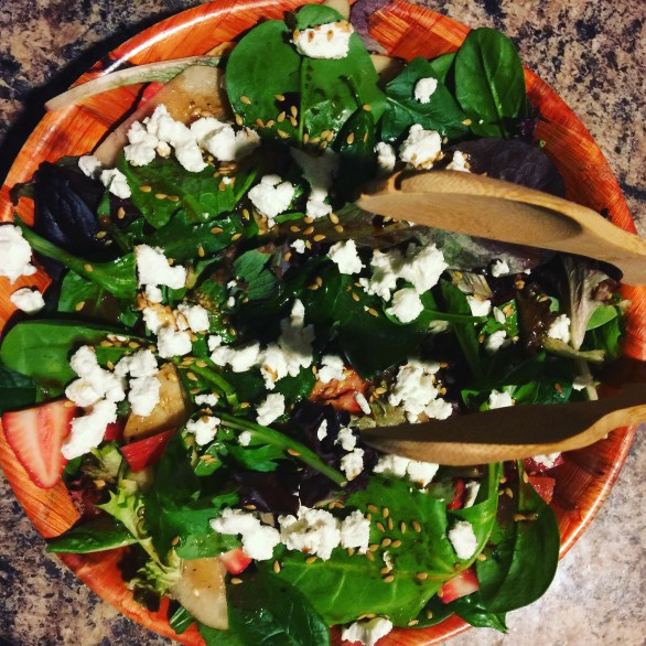 Spinach salad with goat cheese to accompany the squash.
